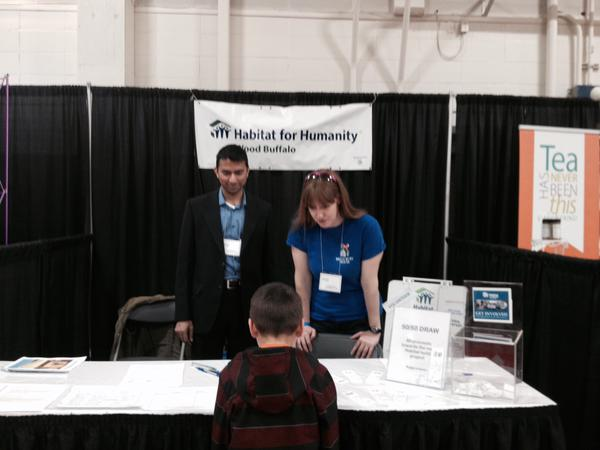 HFH Wood Buffalo Volunteers  at Spring Trade Show Booth